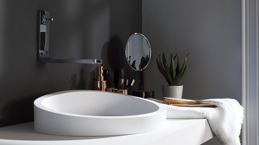 Krion® curves for a more suggestive bathroom: new semi-recessed Almond washbasin