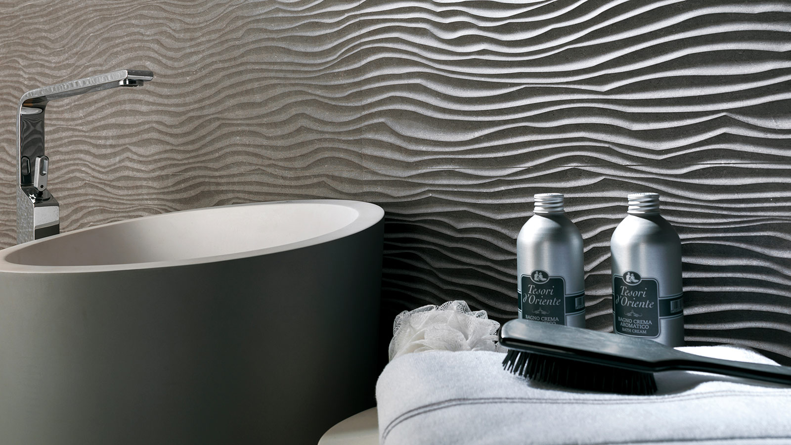 Wave tiles, a fluid wall finish for bathrooms and other spaces